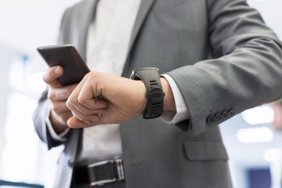 Man-with-Mobile-phone-connected-to-a-smart-watch